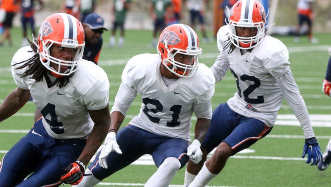 UTEP junior defensive back Dashone Smith, 21, drills with Brandon Moss, 4, and Kalon Beverly, 32, are having to learn a new defense this spring.