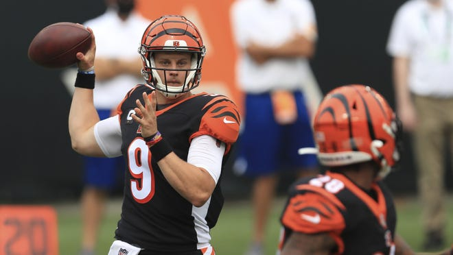 In his NFL debut, quarterback Joe Burrow directed the Bengals to a potential game-tying field goal in the final seconds, moments after a touchdown pass was waved off because of a penalty. [Associated Press]