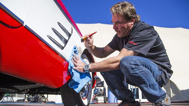 Perry Dodd, owner of European Detail, details a 1961 Corvette at the Barrett-Jackson Collector Car Auction in Scottsdale on Jan. 27, 2016.  Millions of dollars worth of collector cars and memorabilia will be sold at the annual event.