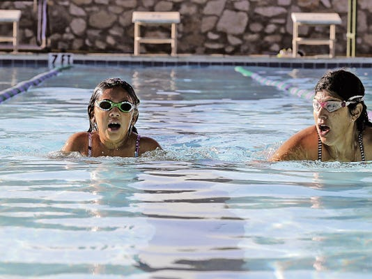 Olivia Guzman 8, and her mother, Selena Solis, swim in the pool at the El Paso Tennis Club Pool, as they practiced for the Sun City Splash & Dash for kids ages 7-15 on July 25.