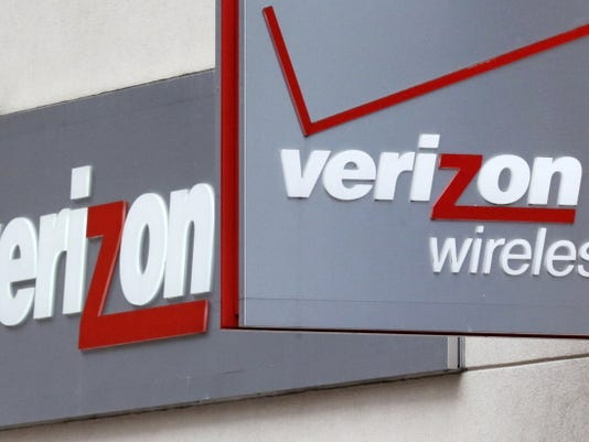 Store signage is shown on June 4, 2014, at a Verizon Wireless retail store at Downtown Crossing in Boston. Verizon, the nation's largest wireless provider, will stop offering phones at discounted prices when customers sign two-year service contracts, taking effect Aug. 13, 2015.
