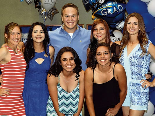 Matt Hollinshead — Current-Argus The Cavegirls softball seniors (Jessica Howard, Lia Granger, team manager Bobby Taylor, Monique Ybarra, Zuriah Leyva, Ashley Trujillo and Shelby Welch) pose toward the end of Tuesday's banquet at the Leo Sweet Center.