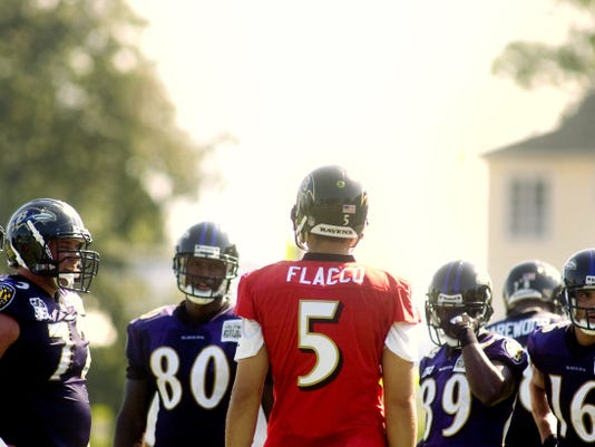 Baltimore Ravens quarterback Joe Flacco talks to his teammates before running through plays during a preseason scrimmage. The Ravens will meet the Eagles in Week Two of the preseason.