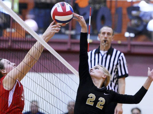 Delone Catholic's Katie Laughman, right, and Susquehannock's Abigail Bentz meet at the net during a girls' volleyball District 3 Class AA quarterfinal last year at Central York High School. Laughman's Squirettes have won the last three YAIAA championships and were the 2013 PIAA champs.