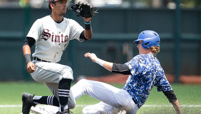 Robinson's Braxton Ashcraft slides in to second before Sinton's shortstop Jordan Martinez is thrown the ball during the fifth inning of the Class 4A State Semifinal at Disch-Falk Field in Austin on Wednesday, June 7, 2017.