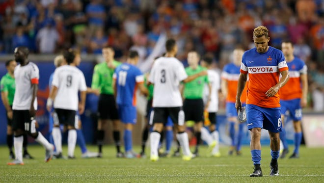 FC Cincinnati's Kenney Walker (6) leaves the field after time expires in the second half of the USL soccer match between FC Cincinnati and the Rochester Rhinos at Nippert Stadium in Cincinnati on Saturday, July 29, 2017.
