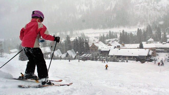 In this Feb. 21, 2008, photo, Hannah Hutchinson, from Minnesota, skis down a run at the Taos Ski Valley, near Taos, N.M