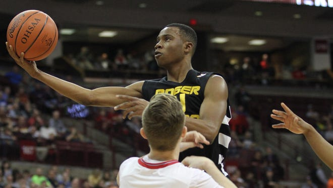 Roger Bacon's Craig McGee Jr drives to the basket.