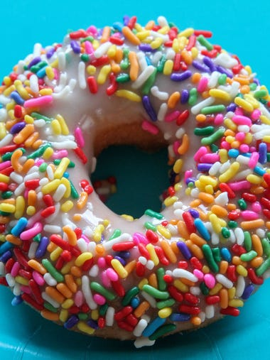 A sprinkle-topped doughnut from Top That! Donuts in