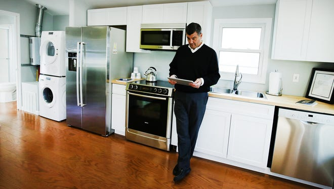 Jim Saber, Vice President  of Business and Technology Development with NextEnergy stands in the kitchen area of this small demo house of NextEnergy's called NextHome in Detroit.