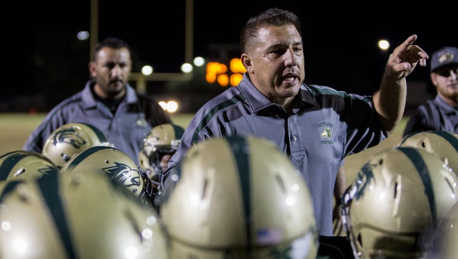Skyline coach Angelo Paffumi talks to his team after defeating Mesa at Skyline High School on Friday, Oct. 30, 2015 in Mesa.