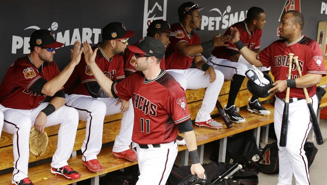 Arizona Diamondbacks A.J. Pollock (11) high-fives his teammate before playing Grand Canyon University during an exhibition game on Feb. 22, 2017 at Salt River Fields in Scottsdale, Ariz.
