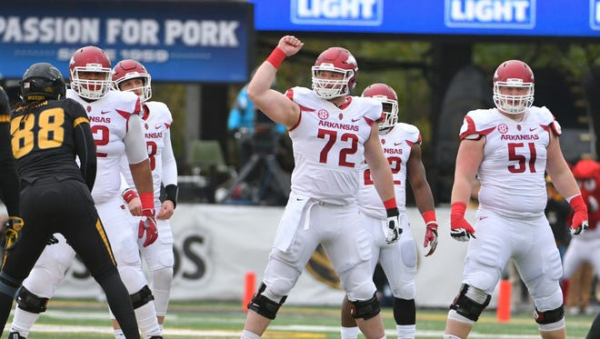 Nov 25, 2016; Columbia, MO, USA; Arkansas offensive lineman Frank Ragnow (72) signals at the line of scrimmage during the first half against Missouri at Faurot Field.