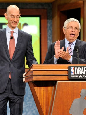 Commissioner David Stern, right, will pass the baton to deputy commissioner Adam Silver in February.