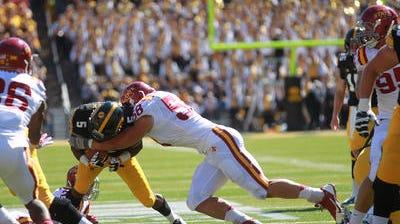 Iowa State's Cory Morrissey tackles Iowa's Damon Bullock during their game at Kinnick Stadium on Saturday.