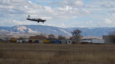 A research aircraft comes in for a landing in Vernal, Utah. Sensitive instruments aboard allow researchers from NOAA and the Cooperative Institute for Research in Environmental Sciences to measure atmospheric levels of methane  and other chemicals during flights through the Uintah Basin oil and gas fields in Utah.