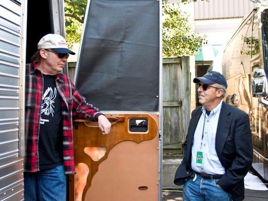 Bob Merlis (right) visits Neil Young at Farm Aid.