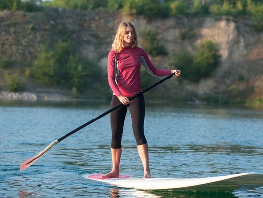 SUP (Stand Up Paddling) Beginner Yoga PHOTO CAPTION