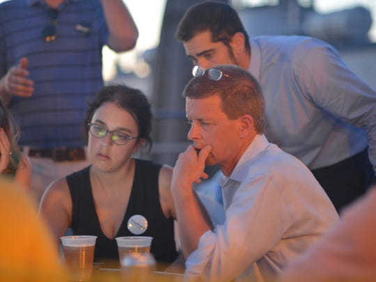 House Speaker Shap Smith, a candidate for the Democratic nomination for lieutenant governor, monitors primary election results with supporters on Tuesday, Aug. 9, 2016, at Breakwater Cafe in Burlington.