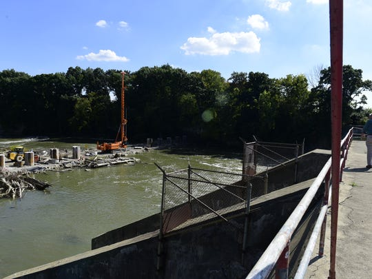 Work continues on completing the ice control structure for the Ballville Dam removal project. Fremont Safety-Service Director Ken Myers said workers had installed 11 of the structure's 15 pillars by Tuesday and could be finished by the end of the week.