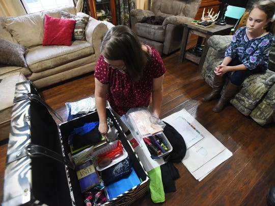 Jessica Morton looks through some of Danielle Cox's belongings that she's saved since her daughter's death.