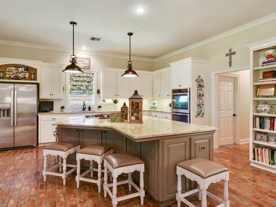 The kitchen is a gourmet's delight with top of the line appliances.
