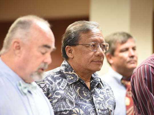 In this Aug. 23, 2017, file photo, David Sablan, former board chairman of the Guam Housing and Urban Renewal Authority, looks to the judge during his arraignment hearing at the Superior Court of Guam.