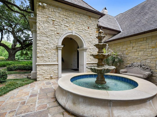 The elegant stone mansion sits on 23 acres of gorgeous,