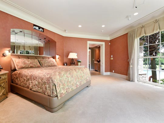 The luxurious master suite includes stunning views