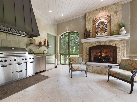 There is an outdoor kitchen and entertainment space