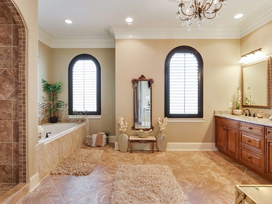 The master bath is a spa-like retreat.