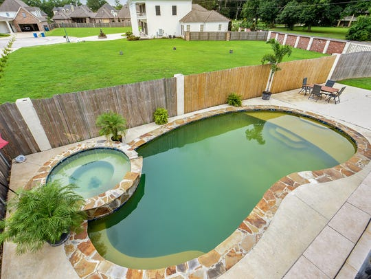 The pool and patio are perfect for entertaining.