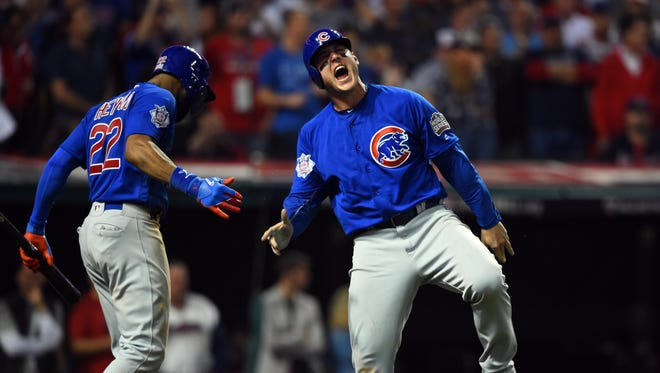 Chicago Cubs first baseman Anthony Rizzo celebrates with right fielder Jason Heyward (22)  after scoring a run against the Cleveland Indians in the 10th inning in game seven of the 2016 World Series at Progressive Field.