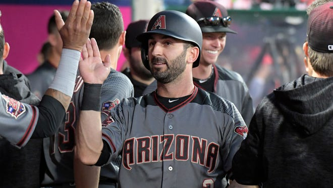 Jun 18, 2018: Arizona Diamondbacks designated hitter Daniel Descalso (3) is congratulated by teammates after scoring in the fourth inning against the Los Angeles Angels at Angel Stadium of Anaheim.