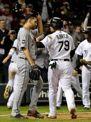 Tigers starting pitcher Matthew Boyd (48) walks past White Sox players after they score in the third inning Friday in Chicago.