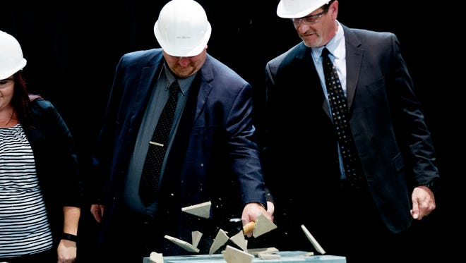 West Town Mall Operations Director Steve Blackwell and mall manager Robert O'Grady hit a piece of tile with a hammer during an announcement ceremony at West Town Mall in West Knoxville, Tennessee on Thursday, September 14, 2017. Mall officials announced that the building will undergo renovations including new color palettes, furniture and signage.
