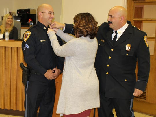 New Corporal Joe Jakubic receives his pin with some assistance from Chief Ron Camacho Monday night. Chambersburg Police promoted 7 officers during the ceremony.