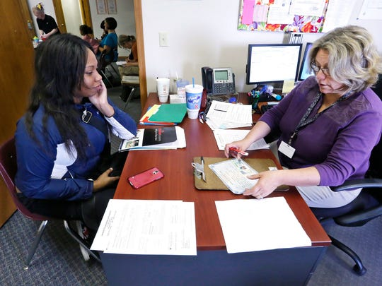 Housing Technician Robin Wright, right, verifies the information on Christy Saffold's pre-application for a Section 8 voucher Wednesday, May 6, 2015, at Lafayette Housing Authority, 100 Executive Drive, Lafayette. The wait list for Section 8 vouchers keeps growing, surpassing the cutoff point of 500 people. Executive Director Michelle Reynolds doesn't want to close the wait list, however, because it gives people hope.