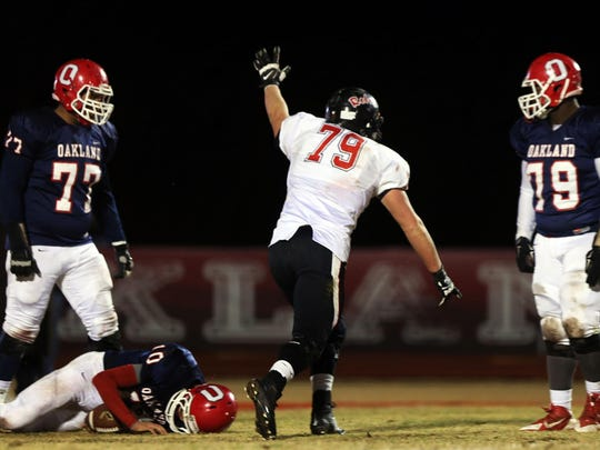 Maryville's Dylan Jackson celebrates after sacking