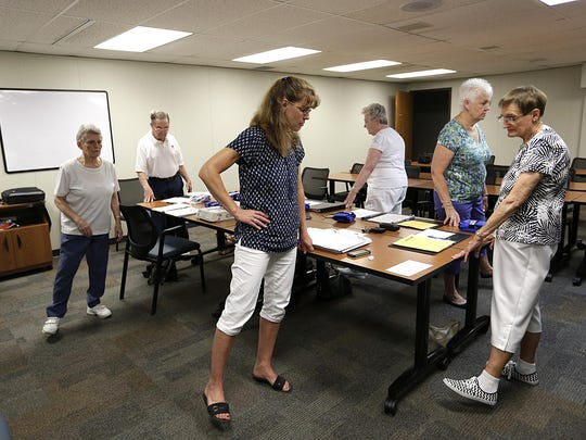 Ann Calnin leads a group of senior citizens through some stepping exercises Aug. 12 at the Aging and Disability Resource Center in Fond du Lac, to help reduce falls while walking.