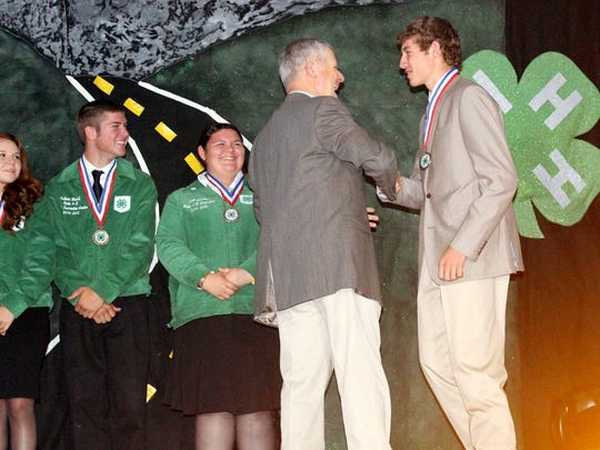 Stacy Swope and Tee Pickett continue to rake in state-wide honors for their work in Luna County 4-H. Swope placed third in an Impromptu Public Speaking competition during the Western National Roundup in Denver. Colorado. She is a junior at Deming High School. Pickett received the National 4-H Congress Award from Jeff Witte, Director/Secretary for the New Mexico Department of Agriculture. He was selected to attend the National 4-H Congress in Atlanta, Georgia Nov. 27-Dec. 1, as part of the New Mexico Delegation. He, along with 14 other 4-H members from around the state were selected to represent New Mexico  Only a limited number of New Mexico youth are selected to attend this event, Selection is made by completing a State 4-H Portfolio which contains records complied throughout the applicants 4-H career. Pickett is a DHS senior.
