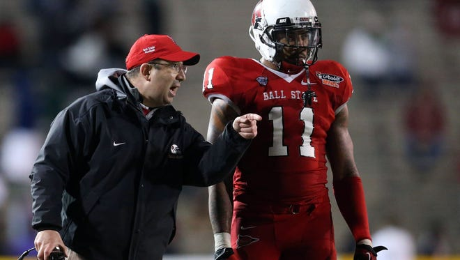 Jan 5, 2014; Mobile, AL, USA; Ball State Cardinals head coach Pete Lembo talks with defensive end Jonathan Newsome (11) at Ladd-Peebles Stadium. Arkansas State Red Wolves defeated the Ball State Cardinals 23-20.