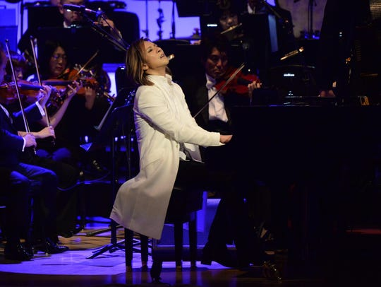 Japanese rock star Yoshiki, pictured on stage at New
