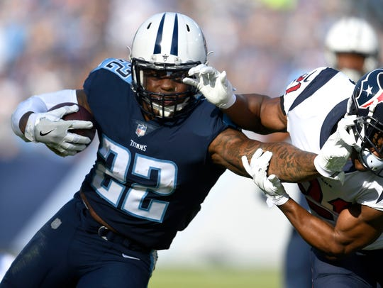 Titans running back Derrick Henry (22) gains yards during the second quarter Sunday.