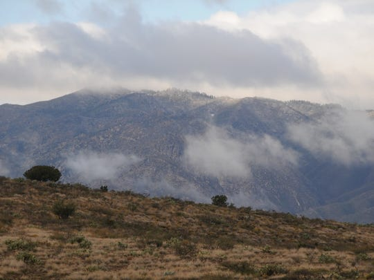 Clouds gather over the Bradshaw Mountains, as seen from the Drinking Snake segment.