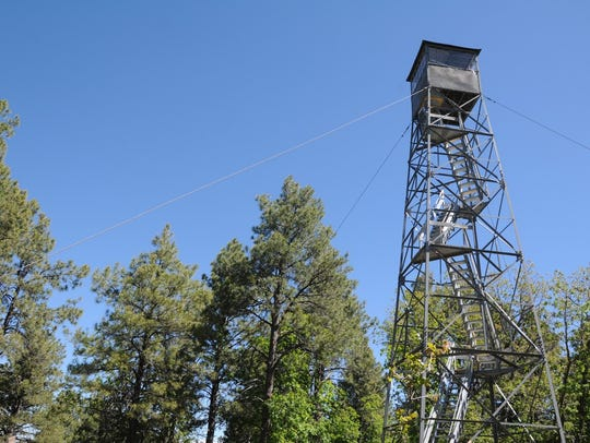 The historic Woody Mountain fire lookout tower can