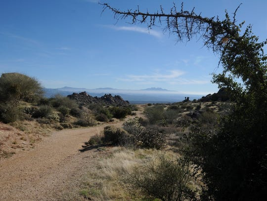 Hikers have views of the Four Peaks from the Marcus