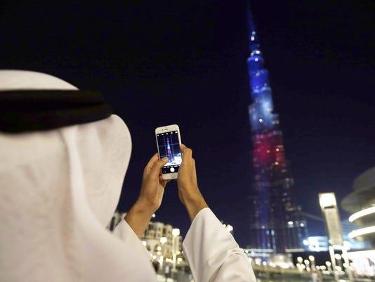Burj Khalifa lit with colors of France flag in Dubai