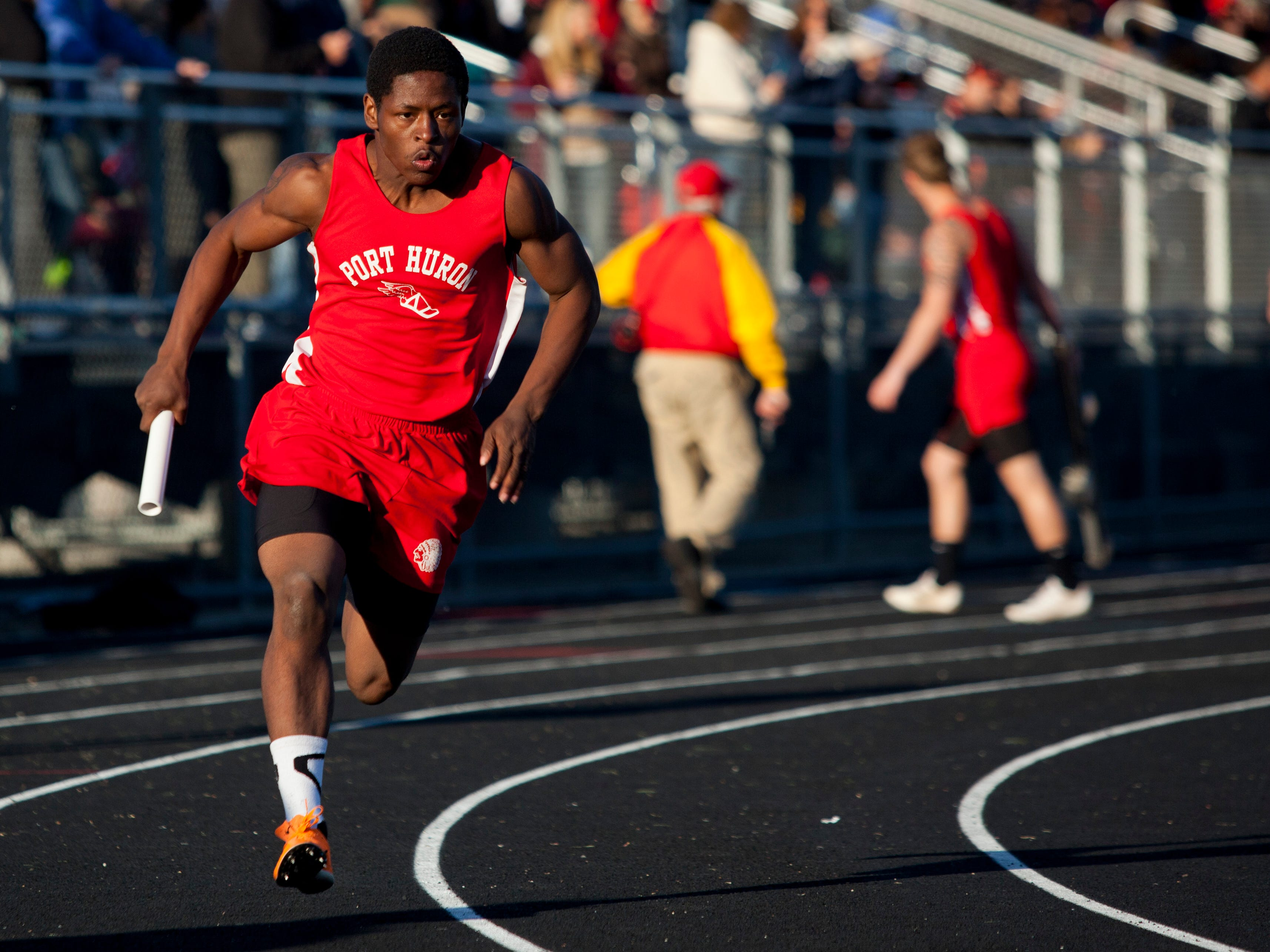 Port Huron junior Jermaine Drake competes in the 400-meter relay during the Meet of Champions Friday, May 22, 2015 at Marysville High School.