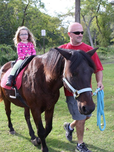 Keira Stevens, 3, of Milford, goes for a pony ride